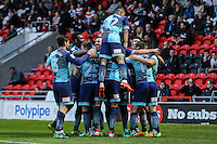 Matthew Bloomfield of Wycombe Wanderers celebrates with team mates after he scores his team's second goal of the game to make it 2-2 during the Sky Bet League 2 match between Doncaster Rovers and Wycombe Wanderers at the Keepmoat Stadium, Doncaster, England on 29 October 2016. Photo by David Horn.