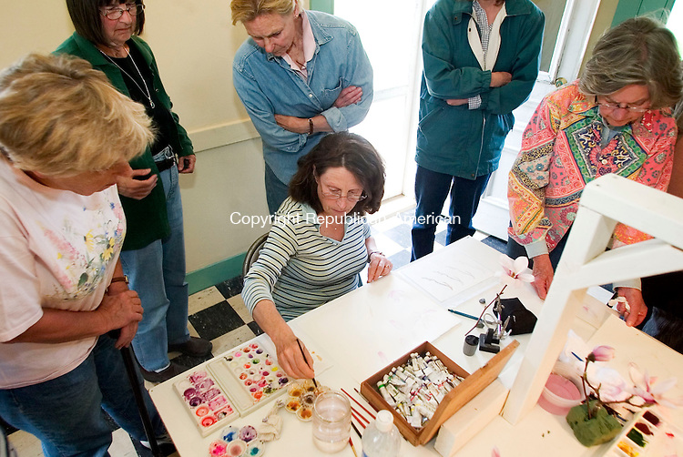 BETHLEHEM, CT- 24 APRIL 07- 042407JT19-<br /> From left, Marilyn Harlow of Thomaston, Cathy Felten of Goshen, Fritzie Updegraph of Washington, Marcia McGowan of Watertown, and Ann Nicoll of Southbury watch a demonstration by Betsy Rogers-Knox during a watercolor workshop on magnolias taught by Rogers-Knox at the Bellamy-Ferriday House in Bethlehem on Tuesday, April 24. <br /> Josalee Thrift Republican-American