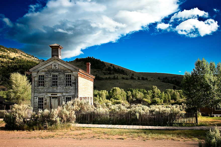 The Bannack school house rest beneath an azure sky in Bannack, Montana.