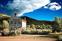 The Bannack school house rest beneath an azure sky in Bannack, Montana.