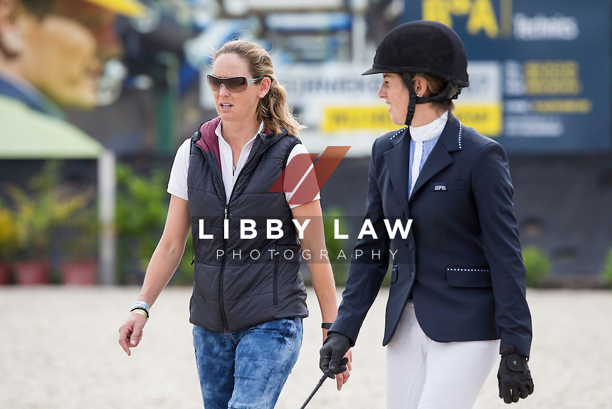 NZL-Amy Collinson (CAPELLO G) walks the course with NZL-Samantha McIntosh:  CSI1* TABLE A AGAINST THE CLOCK WITH JUMP OFF (135cm) 2014 BEL-Bonheiden CSI1*/CSI3* (Friday 27 June) CREDIT: Libby Law COPYRIGHT: LIBBY LAW PHOTOGRAPHY - NZL