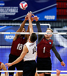 KENOSHA, WI - APRIL 28:  Stevens Institute's Thomas Burrell and Gabe Shankwieler block an attempt from a Springfield College attacker at the Division III Men's Volleyball Championship held at the Tarble Athletic and Recreation Center on April 28, 2018 in Kenosha, Wisconsin. (Photo by Steve Woltmann/NCAA Photos via Getty Images)