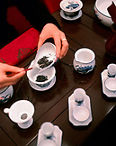 CHINA, Macau, Asia, Sands Macao Hotel, Woman serving Chinese tea, close-up