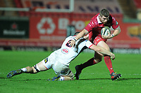 Phil Price of Scarlets is tackled by Nick Timoney of Ulster during the Guinness Pro14 Round 09 match between the Scarlets and Ulster Rugby at the Parc Y Scarlets Stadium in Llanelli, Wales, UK. Friday 23 November 2018