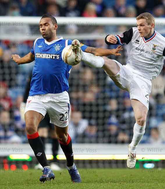 William McKay get to the ball before Rangers defender Kyle Bartley