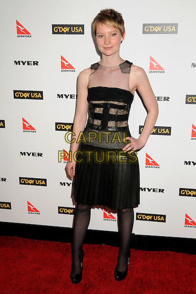 MIA WASIKOWSKA .Attending the 2010 G'Day USA Australia Week Black Tie Gala held at the Hollywood & Highland Grand Ballroom, Hollywood, California, USA, .16th January 2010..arrivals full length black pleated dress sleeveless sheer mesh see thru through dress tights patent shoes leather .CAP/ADM/BP.©Byron Purvis/Admedia/Capital Pictures