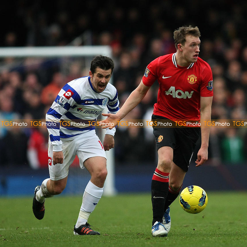 Joey Barton (QPR) screams as Phil Jones (Manchester United) goes by- QPR vs Manchester United - Barclays Premier League Football at Loftus Road, London - 18/12/11 - MANDATORY CREDIT: George Phillipou/TGSPHOTO - Self billing applies where appropriate - 0845 094 6026 - contact@tgsphoto.co.uk - NO UNPAID USE.