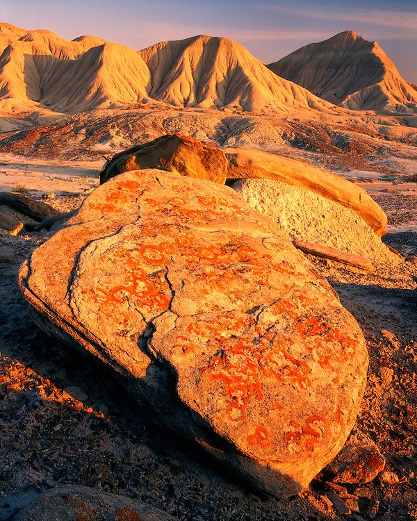 Sunrise light on lichen-covered boulders at Toadstool Park; Sioux County; Oglala National Grasslands, NE