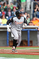 Miguel Gomez (2) of the Salem-Keizer Volcanoes runs to first base during a game against the Hillsboro Hops at Ron Tonkin Field on July 26, 2015 in Hillsboro, Oregon. Hillsboro defeated Salem-Keizer, 4-3. (Larry Goren/Four Seam Images)