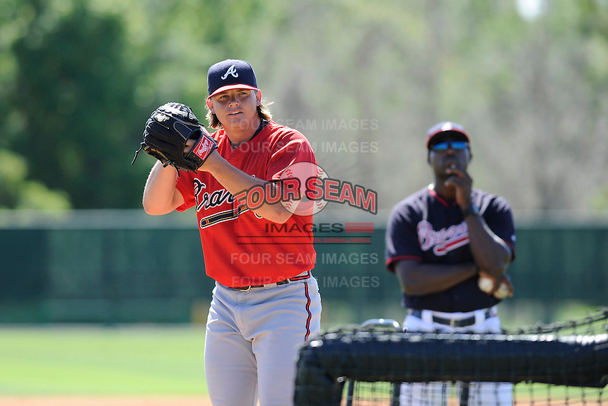 Pitcher Jarrett Miller (52) of the Atlanta Braves farm system in a Minor League Spring Training workout on Monday, March 16, 2015, at the ESPN Wide World of Sports Complex in Lake Buena Vista, Florida. The pitching coach behind him is Derrick Lewis. (Tom Priddy/Four Seam Images)