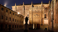 "View from behind of statue of Fray Luis de Leon, Patio de Escuelas, Salamanca University, Salamanca, Spain, pictured on December 18, 2010 in the evening. Fray Luis de Leon (1527/8-91) was Thomas Aquinas Professor of theology at Salamanca from 1561. The statue, by Nicasio Sevilla, was erected in 1869. Salamanca, an important Spanish University city, is known as La Ciudad Dorada (""The golden city"") because of the unique golden colour of its Renaissance sandstone buildings. Founded in 1218 its University is still one of the most important in Spain. Around it the Old Town is a UNESCO World Heritage Site. Picture by Manuel Cohen"