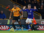 Adama Traore of Wolverhampton Wanderers runs through James Maddison of Leicester City during the Premier League match at Molineux, Wolverhampton. Picture date: 14th February 2020. Picture credit should read: Darren Staples/Sportimage