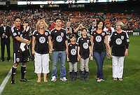 DC United forward Jaime Moreno (99) with family member at the presentation of his last game.  Toronto FC. defeated DC United 3-2 at RFK Stadium, October 23, 2010.