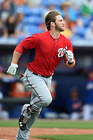 Washington Nationals outfielder Bryce Harper (34) runs to first after losing his helmet during a spring training game against the New York Mets on March 27, 2014 at Tradition Field in St. Lucie, Florida.  Washington defeated New York 4-0.  (Mike Janes/Four Seam Images)