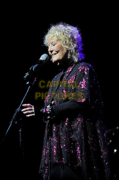 Petula Clark <br /> performing in concert, Theatre Royal, Drury Lane, London, England. <br /> 13th October 2013<br /> on stage live gig performance music black purple floral print jacket singing profile <br /> CAP/MAR<br /> &copy; Martin Harris/Capital Pictures