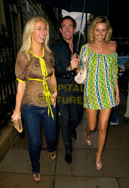 JENNY HALPERN, TIM JEFFREIS & GUEST.The Tatler Summer Party, Home House, London, England..June 27th, 2007.full length jeans denim green yellow blue white brown dress ribbons pattern umbrella.CAP/CAN.©Can Nguyen/Capital Pictures
