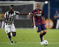 Calcio, finale di Champions League Juventus vs Barcellona all'Olympiastadion di Berlino, 6 giugno 2015.<br /> FC Barcelona's Daniel Alves, right, is challenged by Juventus' Paul Pogba during the Champions League football final between Juventus Turin and FC Barcelona, at Berlin's Olympiastadion, 6 June 2015. Barcelona won 3-1.<br /> UPDATE IMAGES PRESS/Isabella Bonotto