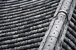 Traditional Japanese roof with clay tile, Kawara, abstract closeup background texture. Image © MaximImages, License at https://www.maximimages.com