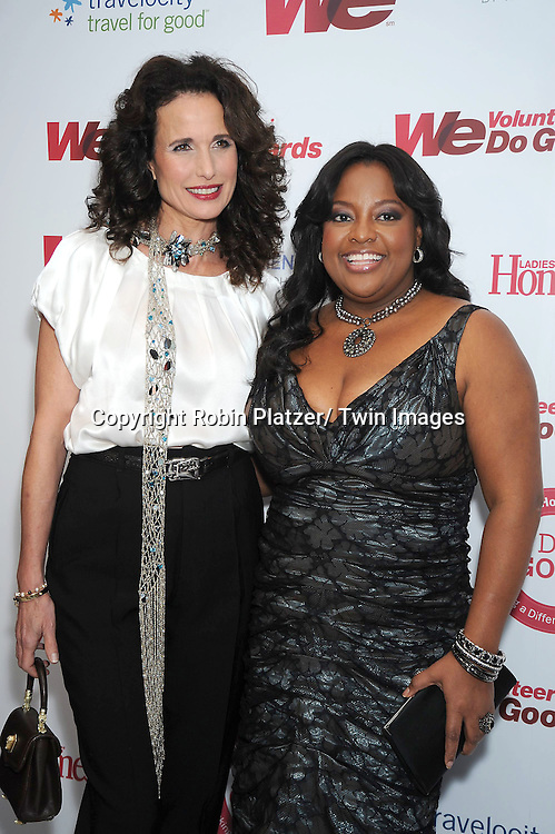 Andie MacDowell and Sherri Shepherd   posing for photographers at the We tv and Ladies' Home Journal's first annual WE Do Good Awards, which honors every day women who make a positive impact through volunteerism, on November 16, 2010 .at Espace in New York City.