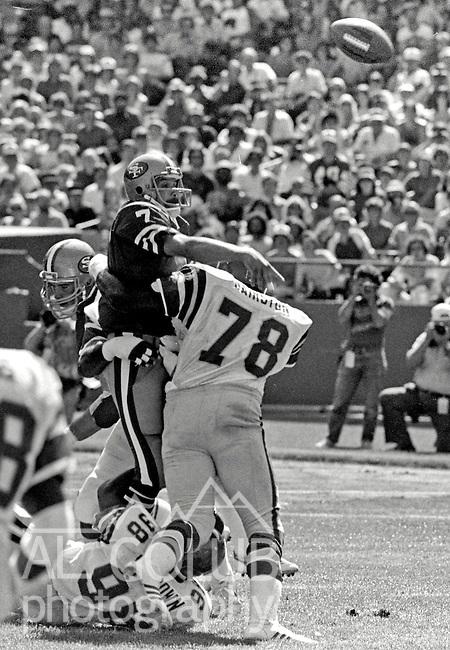 San Francisco 49ers vs. Philadelphia Eagles at Candlestick Park Sunday, September 3, 1983..Eagles beat 49ers 21-17.Philadelphia Eagles Defensive End Carl Hairston (78) and Eagles Defensive End Greg Brown (98) Rush San Francisco Quarterback Guy Benjamin (7)..