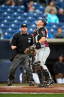 Wisconsin Timber Rattlers catcher Natanael Mejia (14) looks for a foul ball popup in front of umpire Jordan Johnson during the first game of a doubleheader against the Quad Cities River Bandits on August 19, 2015 at Modern Woodmen Park in Davenport, Iowa.  Quad Cities defeated Wisconsin 3-2.  (Mike Janes/Four Seam Images)