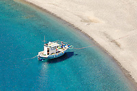 A fishing boat in Agios Minas beach of Karpathos, Greece