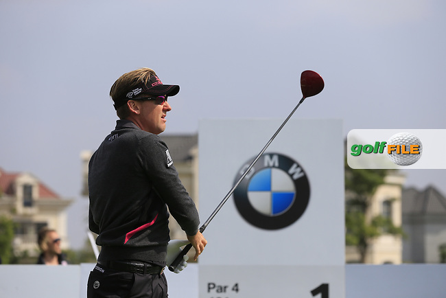 Ian Poulter (ENG) tees off the 1st tee to start his match during Saturday's Round 3 of the 2013 BMW Masters presented by SRE Group held at Lake Malaren Golf Club, Shanghai, China. 26th October 2013.<br /> Picture: Eoin Clarke/www.golffile.ie