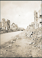 BNPS.co.uk (01202 558833)<br /> Pic: Pen&amp;Sword/BNPS<br /> <br /> A lorry makes its way down the shell-damaged Rue de Lille, Bailleul.<br /> <br /> A poignant collection of images which were taken by a photographer who documented the graves of fallen soldiers on the Western Front have come to light in a new book.<br /> <br /> Ivan Bawtree was one of only three professional photographers assigned to the the Graves Registration Units to photograph and record the graves of fallen First World War soldiers on behalf of grieving relatives. <br /> <br /> His powerful photos of northern France and Flanders are a haunting reminder of the horrors of war and a fascinating insight into the early work of the Imperial War Graves Commission. <br /> <br /> Prior to the First World War, the casualties of war were generally buried in unmarked mass graves.