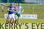 Kerry's Sean Weir gets away from London's Tadhg Healy in the  Kerry V London ALLIANZ NHL DIVISION 2A game at Austin Stack Park on Sunday
