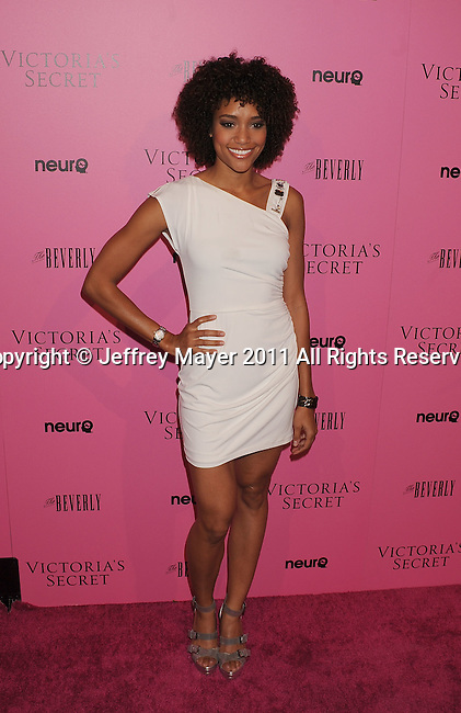"LOS ANGELES, CA - MAY 12: Annie Ilonzeh arrives to the Victoria's Secret 6th Annual ""What Is Sexy? List: Bombshell Summer Edition"" Pink Carpet Event at The Beverly on May 12, 2011 in Los Angeles, California."