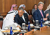 United States President Barack Obama talks to Sheikh Sabah Al-Ahmed Al-Jaber Al-Sabah, Amir of the State of Kuwait, while Secretary of State John Kerry watches on, during a working lunch at the Gulf Cooperation Council-U.S. summit at Camp David, the Presidential Retreat near Thurmont, Maryland, on May 14, 2015. Obama hosted leaders from Saudi Arabia, Kuwait, Bahrain, Qatar, the United Arab Emirates and Oman to discuss a range of issues including the Iran nuclear deal. <br /> Credit: Kevin Dietsch / Pool via CNP