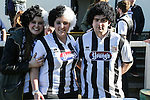 Grimsby fans wearing wigs before the Vanamara Conference League match between Woking and Grimsby Town at the Kingfield Stadium, Woking, Surrey<br /> Picture by David Horn/eXtreme aperture photography +44 7545 970036<br /> 07/03/2015