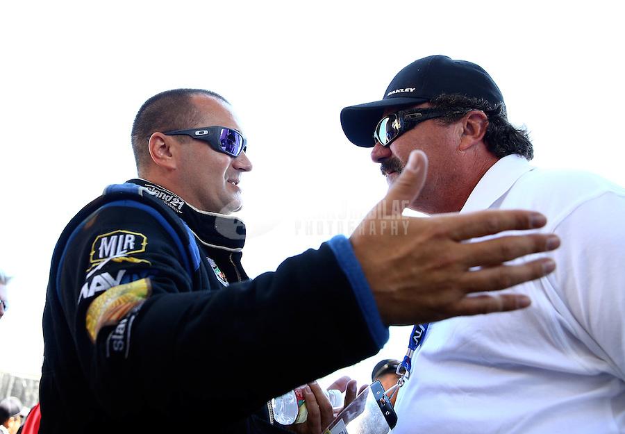 Jul. 21, 2013; Morrison, CO, USA: NHRA top fuel dragster driver Brandon Bernstein (left) talks with Gary Scelzi during the Mile High Nationals at Bandimere Speedway. Mandatory Credit: Mark J. Rebilas-