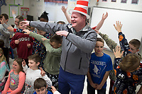 NWA Democrat-Gazette/CHARLIE KAIJO Mayor Greg Hines (center) dabs with 4th graders, Friday, March 2, 2018 at Bellview Elementary School in Rogers.<br /><br />Bellview Elementary School celebrated Read Across America with some special guest readers
