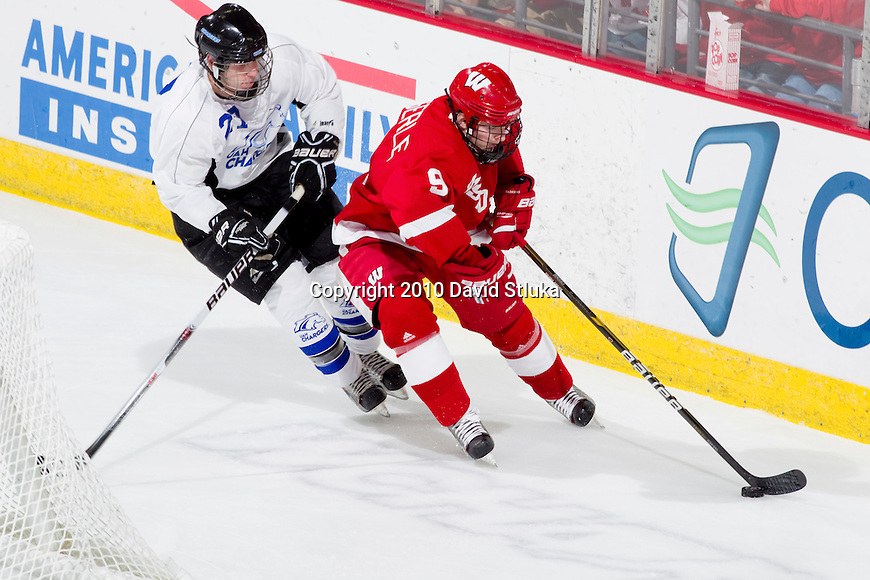 Wisconsin Badgers Mark Zengerle (9) handles the puck during an NCAA hockey game against the Alabama Huntsville Chargers at the Kohl Center in Madison, Wisconsin on October 15, 2010. The Badgers won 7-0. (Photo by David Stluka)