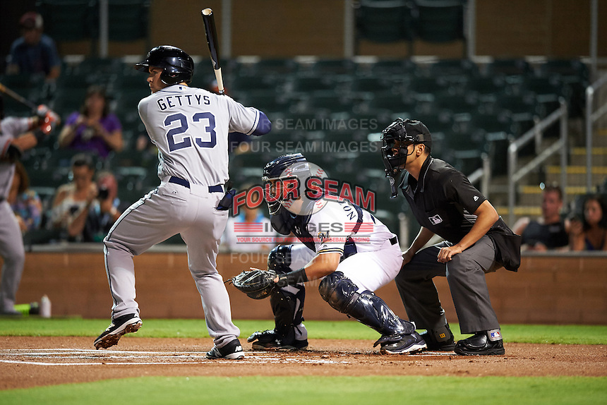 Peoria Javelinas Michael Gettys (23), of the San Diego Padres organization,at bat in front of Salt River Rafters catcher Jacob Nottingham (24), of the Milwaukee Brewers organization, and umpire Gabe Morales during a game on October 11, 2016 at Salt River Fields at Talking Stick in Scottsdale, Arizona.  The game ended in a 7-7 tie after eleven innings.  (Mike Janes/Four Seam Images)
