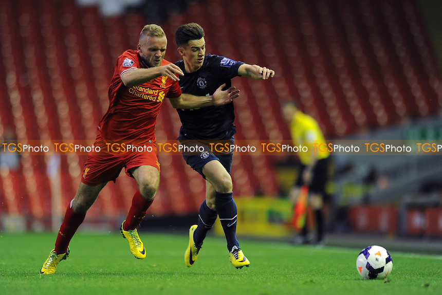 Ryan McLaughlin of Liverpool vies for the ball with Tom Lawrence of Manchester United - Liverpool Under-21 vs Manchester United Under-21 - Barclays Under-21 Premier League Football at Anfield, Liverpool - 02/05/14 - MANDATORY CREDIT: Greig Bertram/TGSPHOTO - Self billing applies where appropriate - 0845 094 6026 - contact@tgsphoto.co.uk - NO UNPAID USE