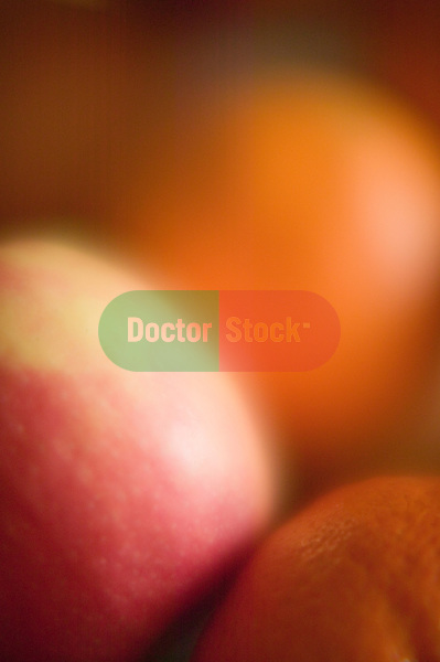 orange and apples closeup and soft focus abstract of fruit