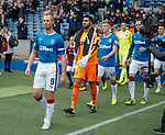 Captain Kenny Miller leads out the teams