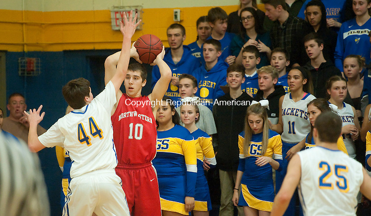 WINSTED, CT--- -011516JS11--Northwestern's Jayson Reola (10) looks to pass while being defended by Gilbert's Ian Ryan (44) during their game Friday at the Gilbert School in Winsted. <br />  Jim Shannon Republican-American