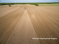 63801-10120 Farmer tilling field before planting corn-aerial Marion Co. IL
