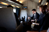 Washington, DC - June 1, 2009 -- United States President Barack Obama is briefed by Matt Flavin, Director of Veterans and Wounded Warrior Policy, aboard Marine One enroute to the National Naval Medical Center in Bethesda, Maryland, June 1, 2009.  Assistant White House press secretary Tommy Vietor and personal aide to the president Reggie Love sit at right..Mandatory Credit: Pete Souza - White House via CNP