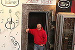 WATERTOWN, CT-26 December 2013-122613LW04 - Coung Vo stands next to the old bank vault turned photo booth in the old Heminway Building on Main Street in Watertown. Vo and his partner, Rich Leoone Jr., are opening a new acoustic music venue called The Lounge, in the space Jan. 2.<br /> Laraine Weschler Republican-American