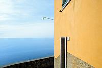 - landscape with yellow house and sea in Corniglia village (Cinque Terre)....- paesaggio con casa gialla e mare nel paese di Corniglia (Cinque Terre)