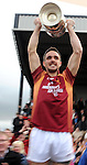 XXjob 06/01/2013* (SPORT) Duagh captain Kieran Quirke raises the cup aloft  after his side defeated  Beale  in the North Kerry football final at Frank Sheehy Park Listowel on Sunday . Picture: Eamonn Keogh ( MacMonagle, Killarney)