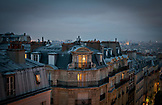 FRANCE, Paris, Parisian rooftops in Montmartre during the evening, City view in the background