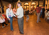 """Alumni have dinner and then dance at the """"Jumpin' & Jivin'"""" event on Branca Patio, Johnson Student Center on Friday, Alumni Reunion Weekend 2009 at Occidental College on June 12, 2009. (Photo by Marc Campos, Occidental College Photographer)"""