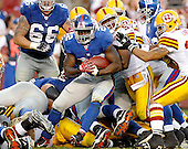 Landover, MD - September 23, 2007 -- New York Giants running back Reuben Droughns (22) is swarmed by the Washington Redskins defense in the fourth quarter at FedEx Field in Landover, MD on Sunday, September 23, 2007.  The Giants won the game 24 - 17..Credit: Ron Sachs / CNP.(RESTRICTION: NO New York or New Jersey Newspapers or newspapers within a 75 mile radius of New York City)