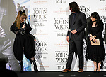 """Singer Kyary Pamyu Pamyu (L) shows actor Keanu Reeves a ninja-style dress during a stage greeting for the movie """"John Wick: Chapter 3 - Parabellum"""" in Tokyo, Japan, September 10, 2019. The movie will be released in Japan on October 4. JIJI PRESS PHOTO / MORIO TAGA"""