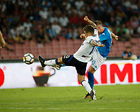 Piotr Zielinski shoots and scores during the  italian serie a soccer match,between SSC Napoli and Atalanta      at  the San  Paolo   stadium in Naples  Italy , August 27, 2017